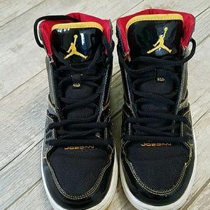 Nike Jordans black and yellow